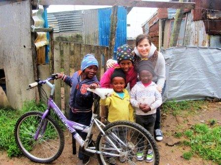 Volunteer Debbie with kids from the Township