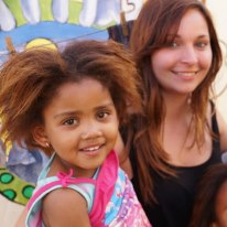 Jasmin with Kaylen, a holiday programme attendee and one of Mama Iris' pupils!